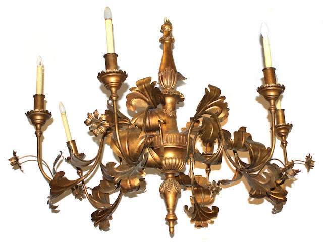 A large Rococo style giltwood and tôle six light chandelier
