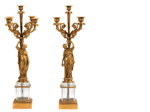 A pair of Neoclassical style gilt bronze and glass five light candelabra