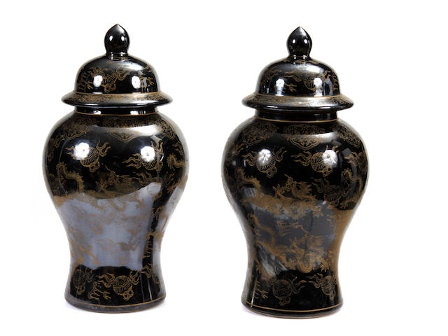A pair of Chinese gilt decorated black covered jars