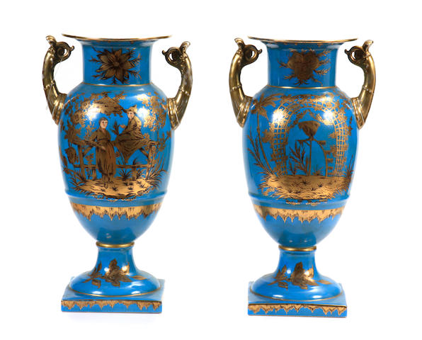A pair of Neoclassical style chinoiserie decorated urns