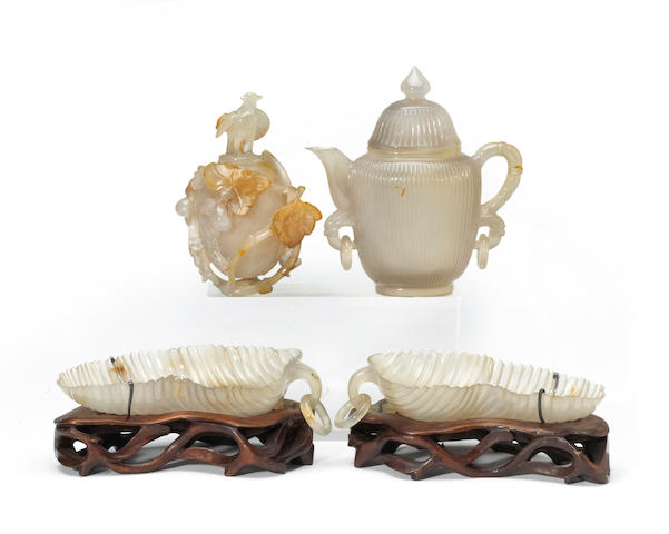 A group of four small carved agate decorations
