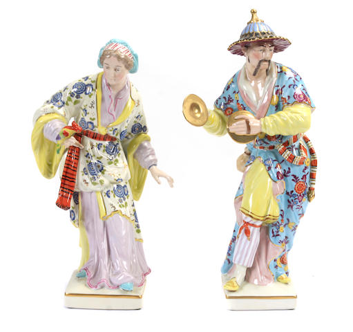 A pair of German Rococo style porcelain chinoiserie figures
