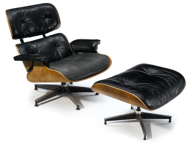 A Charles and Ray Eames leather lounge chair and ottoman