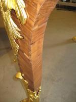 A Louis XV style gilt bronze mounted kingwood bureau plat