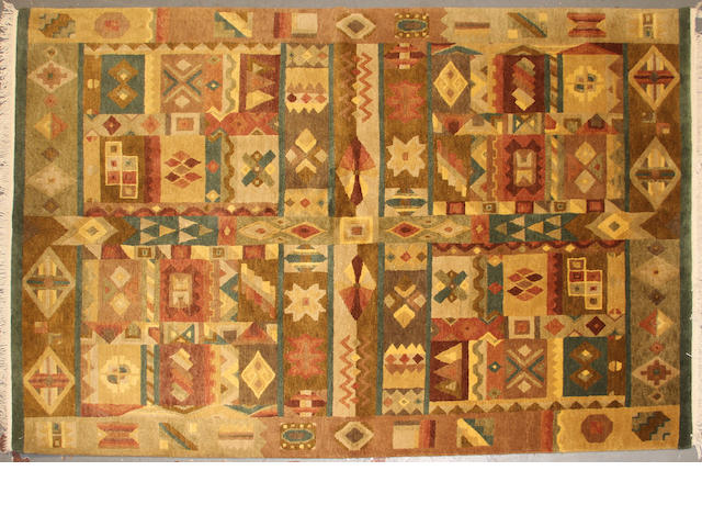 A Tibetan carpet  size approximately 5ft. 9in. x 9ft. 1in.