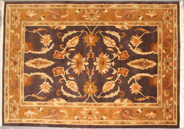 A Tibetan carpet  size approximately 5ft. 9in. x 8ft. 9in.