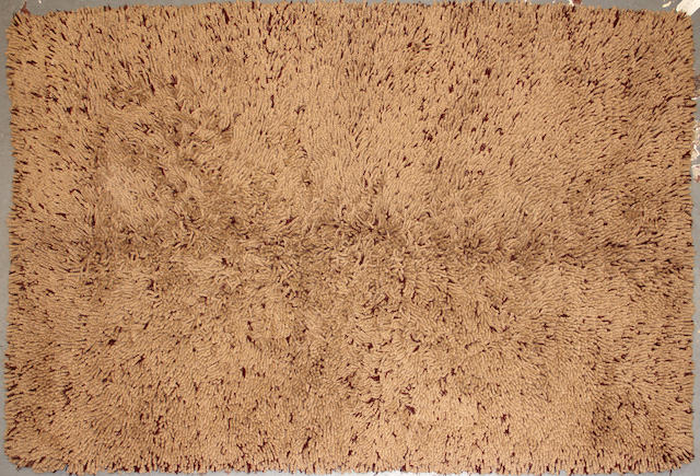 A custom made carpet  size approximately 5ft. 3in. x 8ft. 2in.