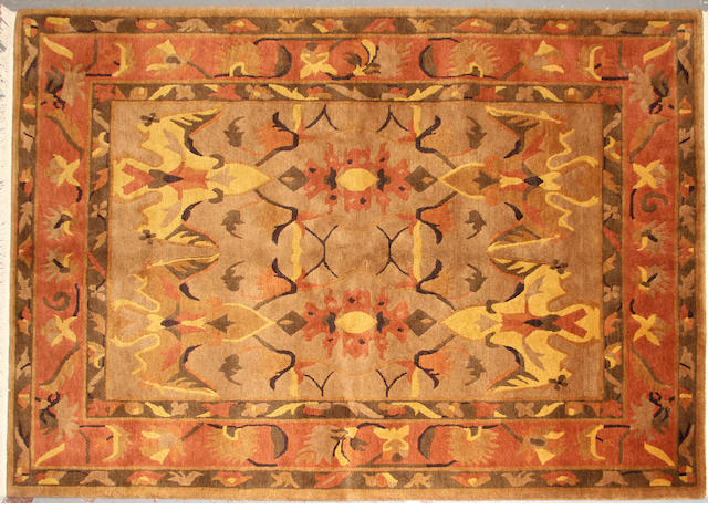 A Tibetan carpet  size approximately 5ft. 11in. x 8ft. 5in.