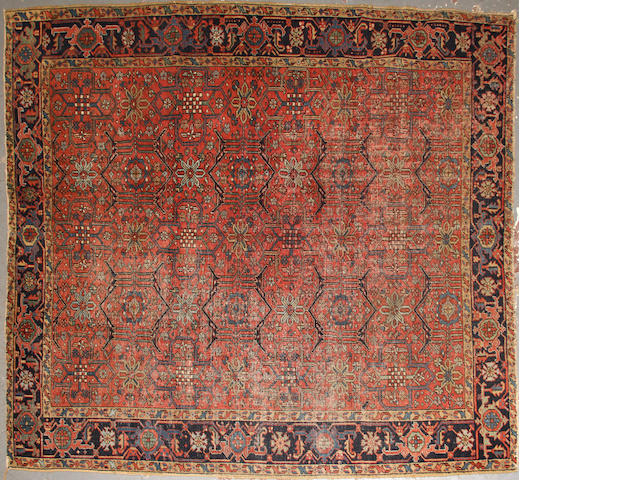 A Heriz carpet  size approximately 7ft. 7in. x 8ft. 7in.