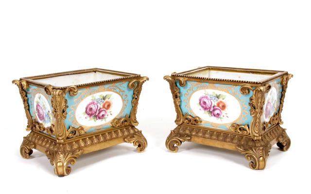 A pair of Rococo style gilt bronze mounted porcelain jardinières