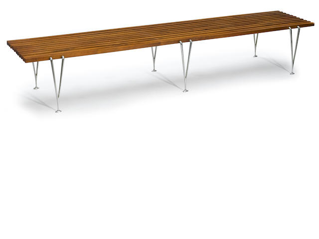 A wood and steel slat bench