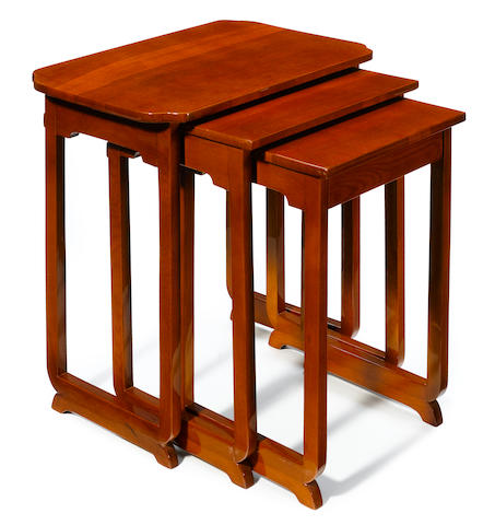 A nest of three Art Deco fruitwood tables
