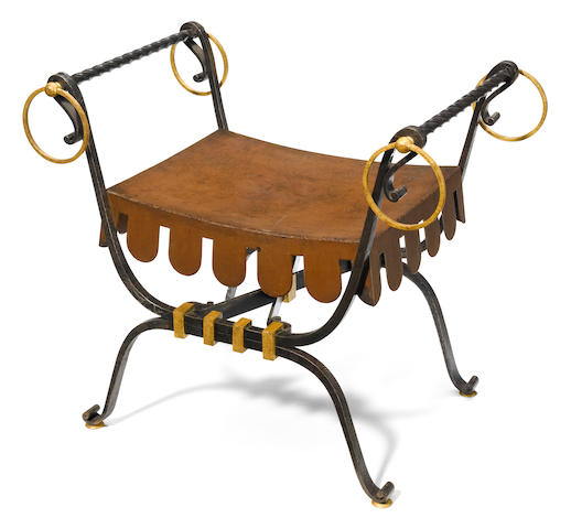 A wrought-iron and parcel gilt stool attributed to Gilbert Poillerat