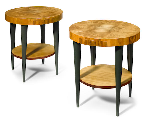 A pair of figured walnut and faux leather side tables, most probably by Gilbert Rohde