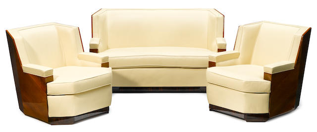 A three piece Art Deco macassar and leather seating group comprising: A sofa and pair of club chairs