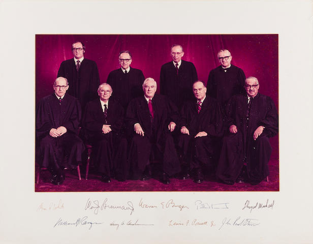 "SUPREME COURT OF THE UNITED STATES. Photograph Signed (""Byron R. White,"" ""Wm. J. Brennan Jr.,"" ""Warren E. Burger,"" ""Potter Stewart,"" ""Thurgood Marshall,"" ""William H. Rehnquist,"" ""Harry A. Blackmun,"" ""Lewis F. Powell, Jr.,"" ""John Paul Stevens""), 9 by 14 inches on larger mount, [Washington, DC, 1975–1981],"