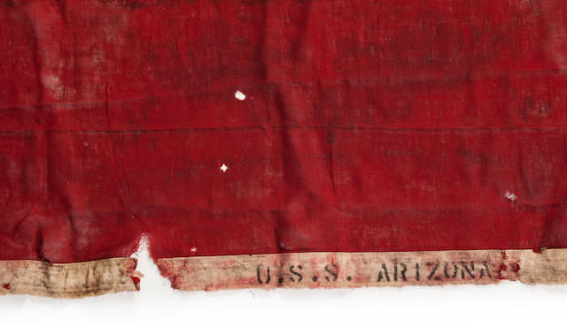 "A 48-star American flag recovered from onboard the U.S.S. Arizona  1941 55 x 95 in. (139.7 x 241.3 cm.) the American flag, 46 x 63 in. (116.8 x 160 cm.) the ""B"" flag. 2"