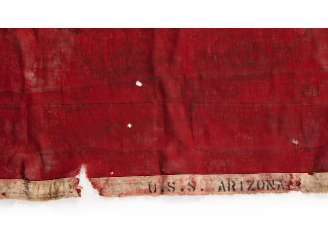 """A 48-star American flag recovered from onboard the U.S.S. Arizona  1941 55 x 95 in. (139.7 x 241.3 cm.) the American flag, 46 x 63 in. (116.8 x 160 cm.) the """"B"""" flag. 2"""