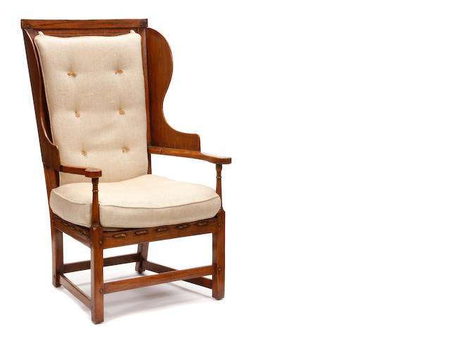 A pair of Therien Studios stained wood and upholstered wingback armchairs
