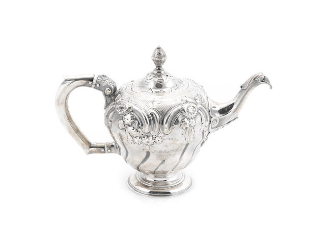 A George III sterling silver  bachelor's teapot probably by John Bayley, London 1758