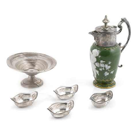 A group of sterling silver hollowware, comprising: a set of twelve Gorham nut dishes; an Empire weighted tazza (damaged) and a silverplate mounted porcelain jug, Locke & Co.