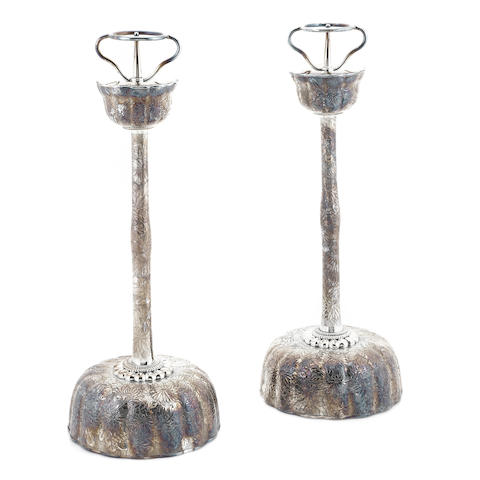 A pair of Japanese silverplate floral repousse-decorated altar sticks