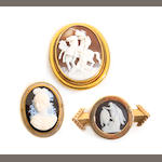 A group of three cameo and gold brooches