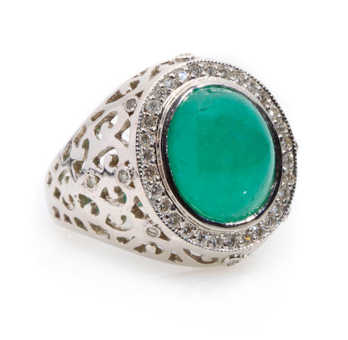 An emerald cabochon, diamond and 18k white gold ring
