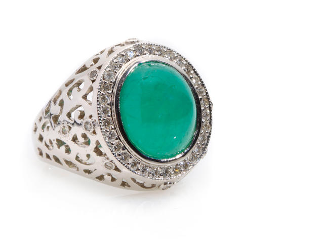 An emerald, diamond and 18k white gold ring