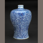 A blue and white porcelain vase with lotus decoration Kangxi mark 19th century