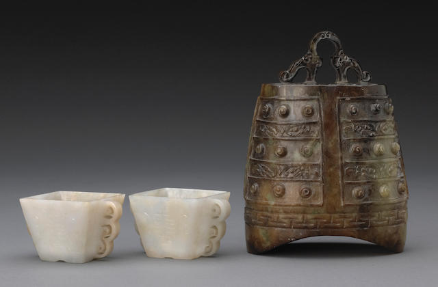 A group of three carved jade decorations