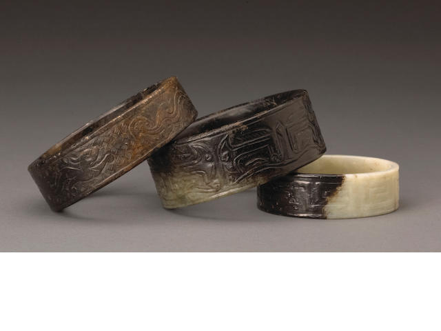 A group of three archaistic carved jade bracelets