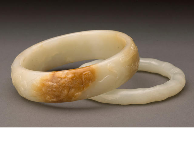 Two carved white jade bangles