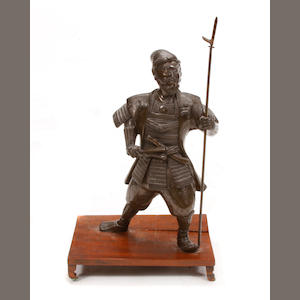 A bronze figure of a Samurai