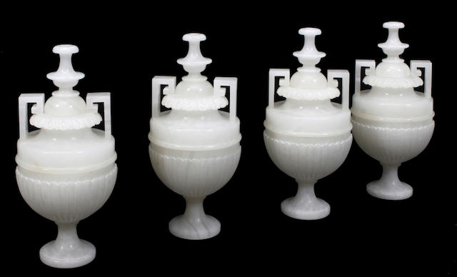 A set of four Neoclassical style carved alabaster urns
