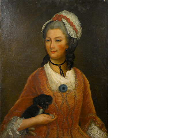 English School A portrait of a lady, half-length, holding a small black dog 32 x 25 1/2in