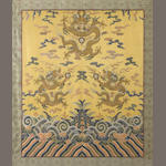 A textile fragment, yellow silk and dragons Qing dynasty framed and glazed (plastic cracked)