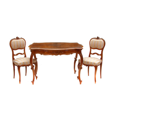 A suite of Louis XV style dining room furniture