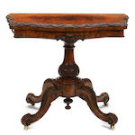 A Victorian figured walnut fold top games table