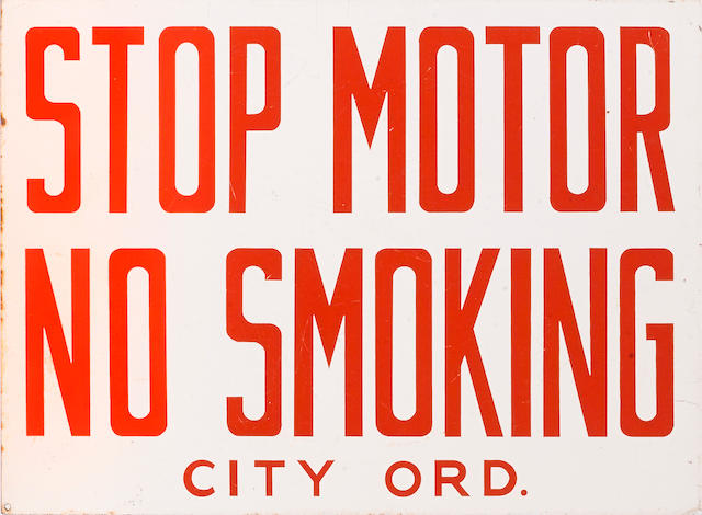 A 'Stop Motor, No Smoking-City Ordinance' flange sign