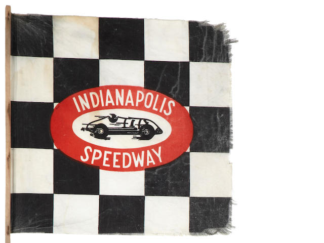 A 1940s era Indianapolis Speedway souvenir checkered stick flag