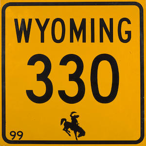 A vintage Wyoming Highway 330 road sign
