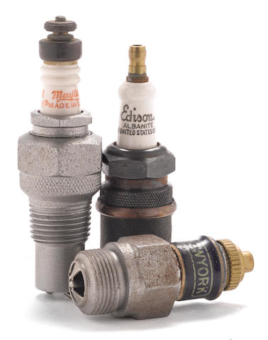 A lot of three spark plugs, circa 1920s