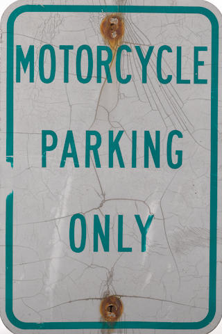 A Motorcycle Parking Only Sign,