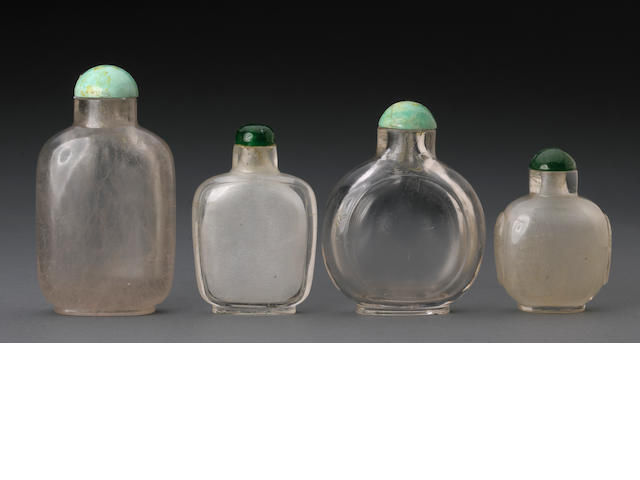 A group of four carved rock crystal and glass snuff bottles 1820-1880