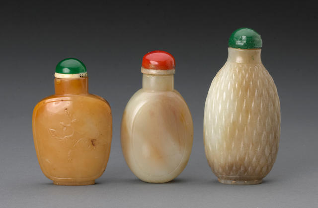 A group of three hardstone snuff bottles, two of jade and one of carnelian 19th and 20th century