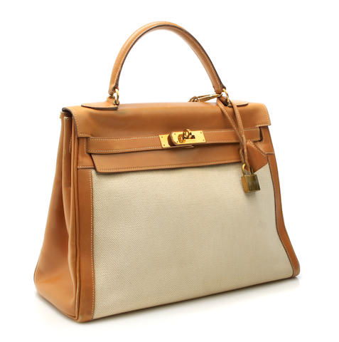 An Hermès canvas and leather Kelly handbag