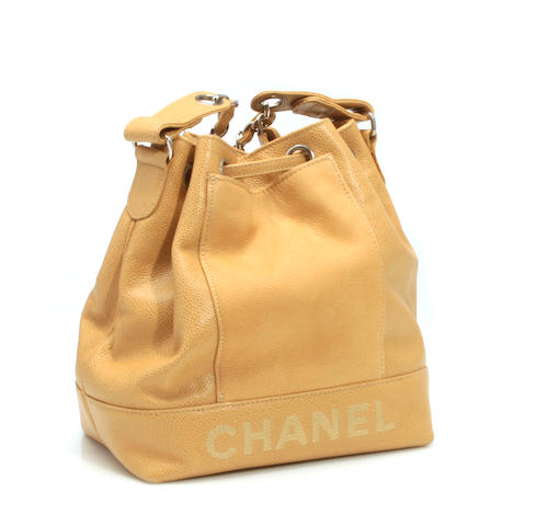 A Chanel beige leather BUCKET handbag