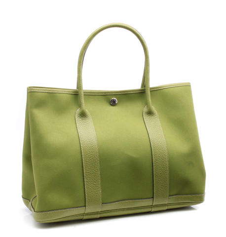 An Hermès green canvas and leather Garden Party tote bag