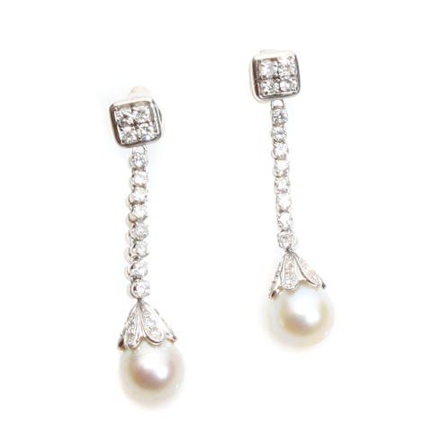 A pair of diamond, cultured pearl and 14k white gold dangle earrings with jackets